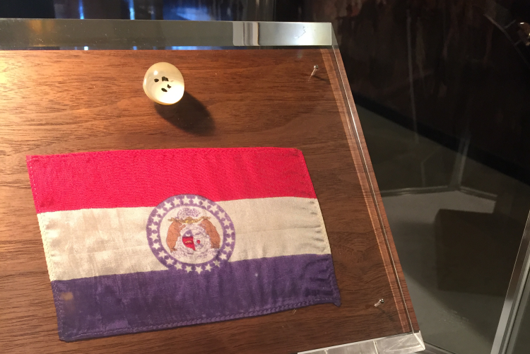 Missouri state flag and small moon rocks