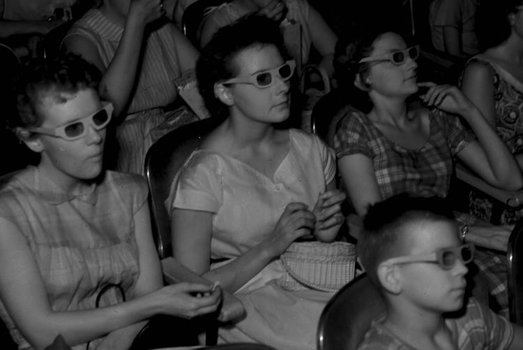 People watching a 3-D movie