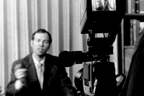 Larry Rice talking to a tv camera