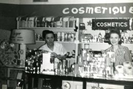 Elaine Davis, left, and Mary Jane Barnett stand behind the cosmetic counter of Co-op Cut Rate Drug Store circa 1940.