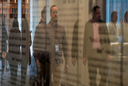 SHSMO staff members reflected in exhibition glass